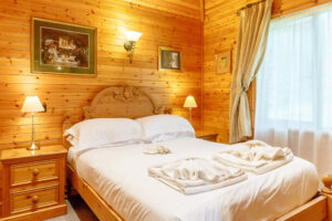 Interior shot of a bedroom in a lodge at Tilford Woods