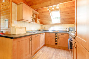 Interior shot of a kitchen in a lodge at Tilford Woods