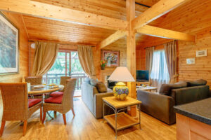 Interior shot of an open plan living area in a lodge at Tilford Woods