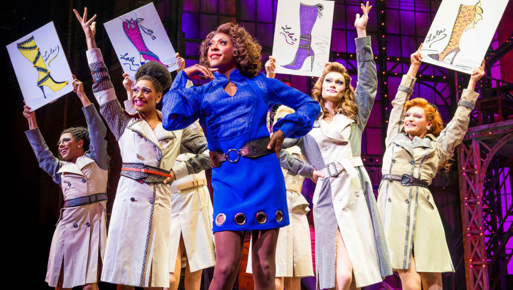 Photo of cast members on stage during a performance of Kinky Boots