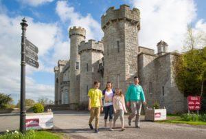 Family walking past a Welsh castle