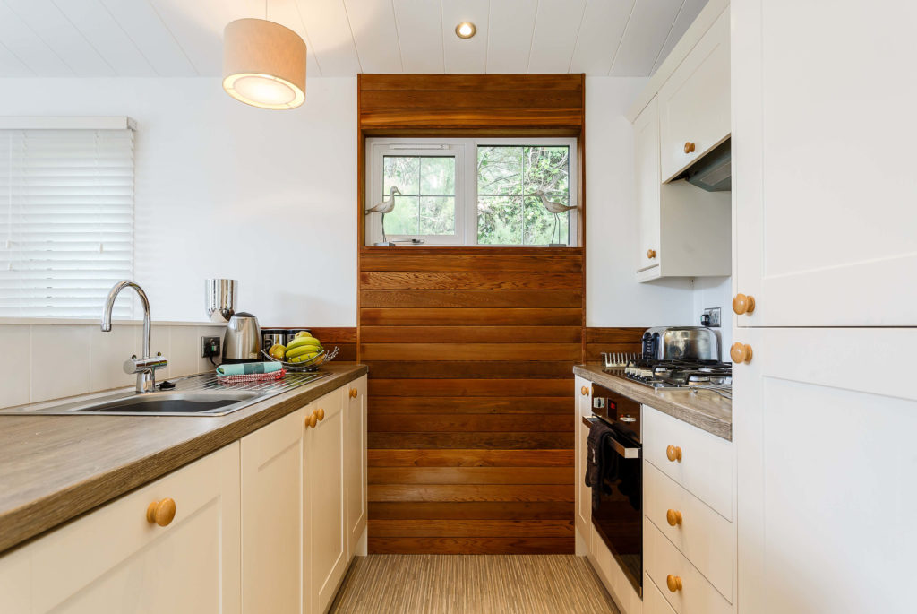 Interior shot of a kitchen in a lodge at Mullion Cove