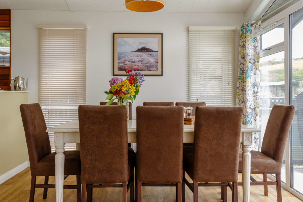 Interior shot of a dining area in a lodge at Mullion Cove