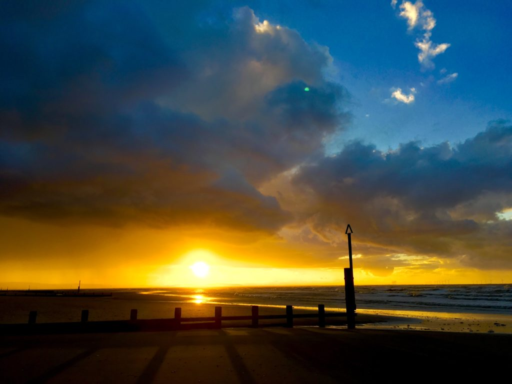 Beautiful sunset at Rhyl beach in North Wales