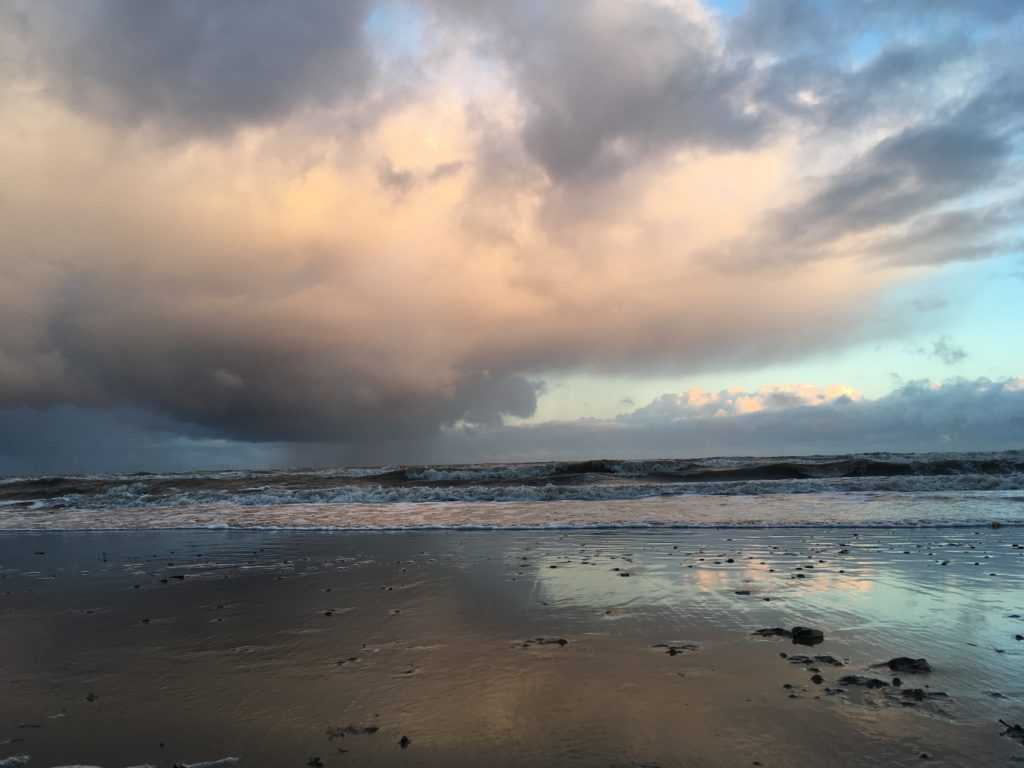 Photo of the cloudy sky during the day at Rhyl beach