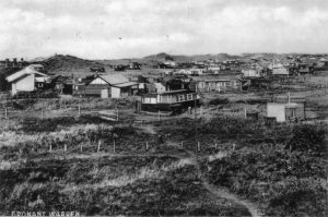 Old photo of caravans and houses at Talacre Beach