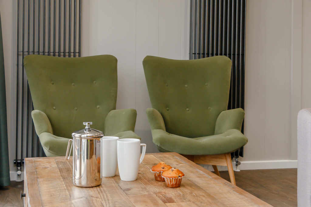 Interior shot of arm chairs in a Cheddar Woods lodge