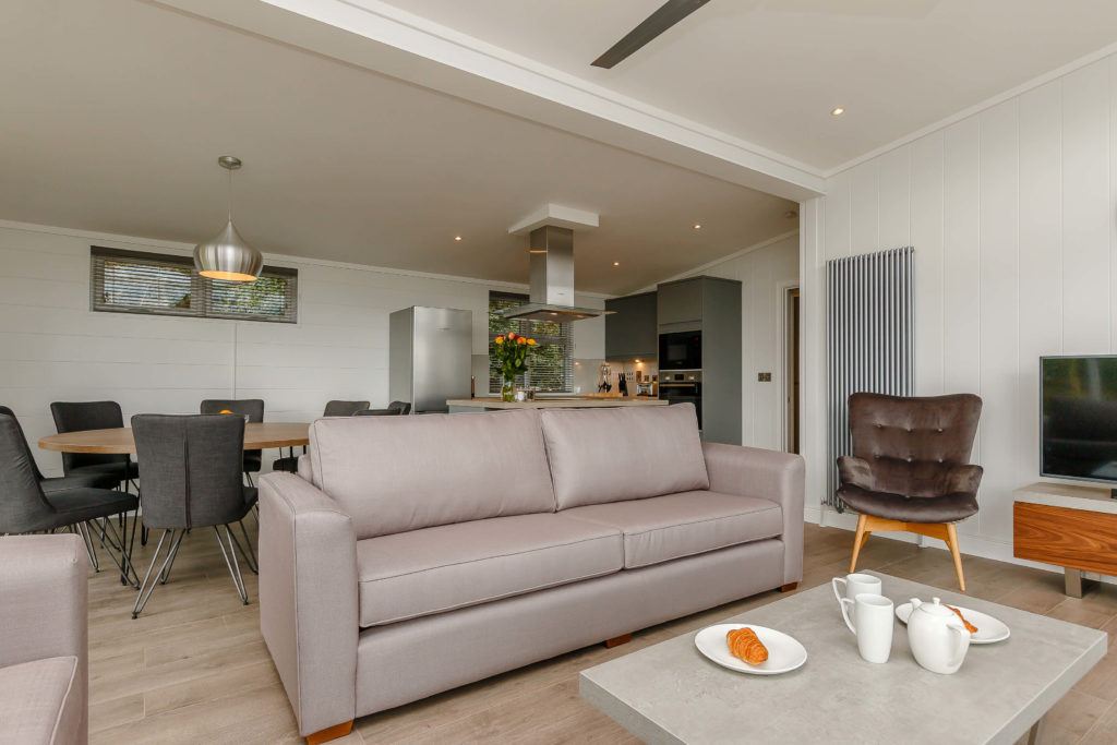 Interior shot of the open plan living area in a Cheddar Lodge