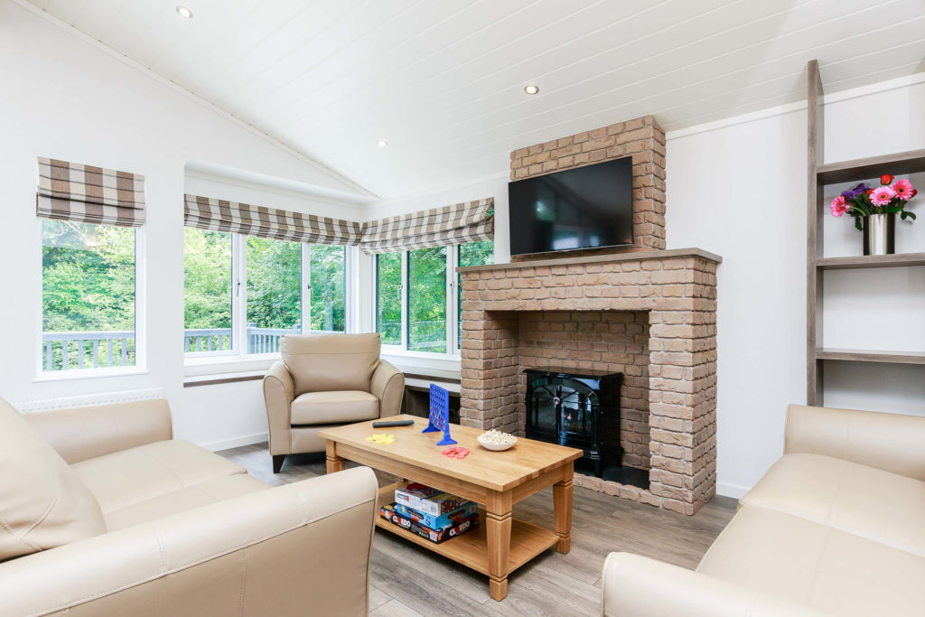 Interior shot of a Bath Mill lodge lounge and fireplace