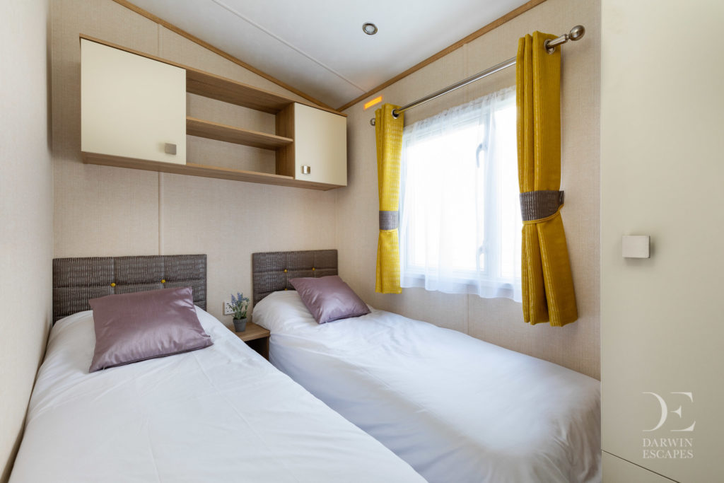 Interior shot of a twin bedroom in the Carnaby Oakdale static caravan