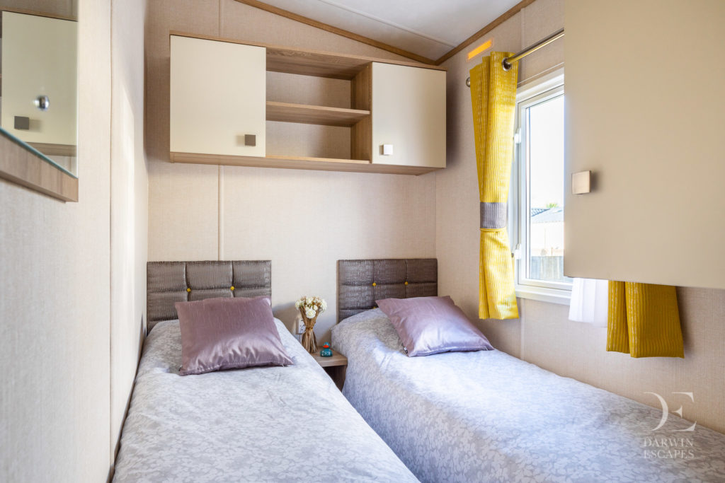 Interior shot of the twin bedroom in the Carnaby Oakdale static caravan