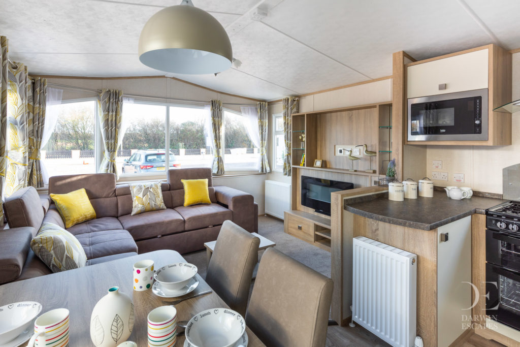 Interior shot of the open plan living area in the Carnaby Oakdale static caravan