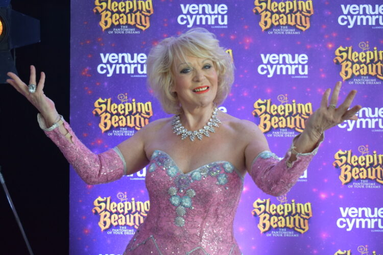 Sherrie Hewson posing for a photo at the sleeping beauty press day