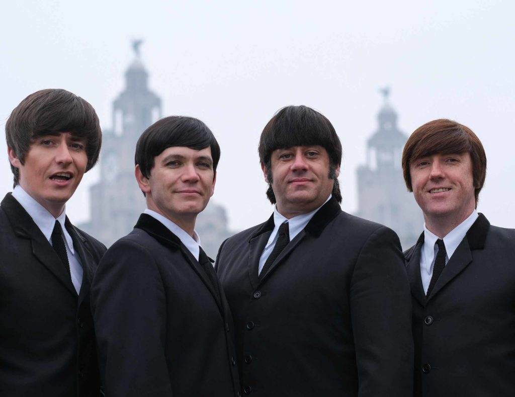 Photo of the band members in the Mersey Beatles