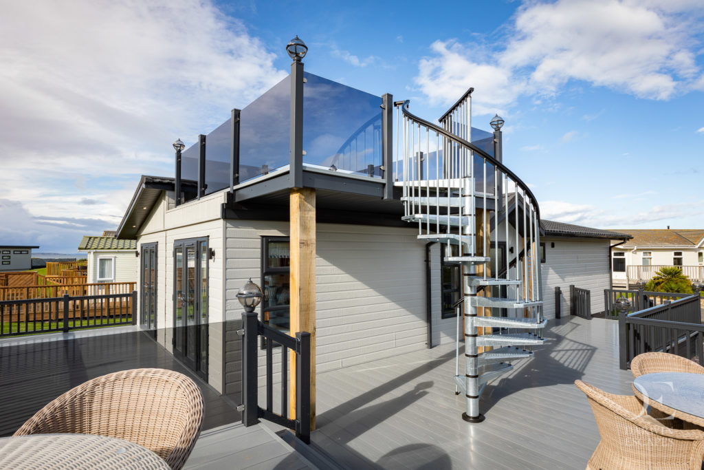 Exterior shot of the roof terrace and decking on the Bowmoor Lodge