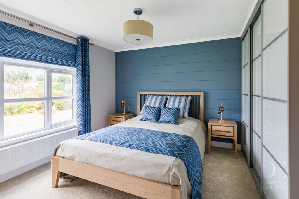 Interior shot of the master bedroom in the Bowmoor lodge
