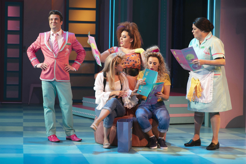 Photo of the cast performing in Club Tropicana