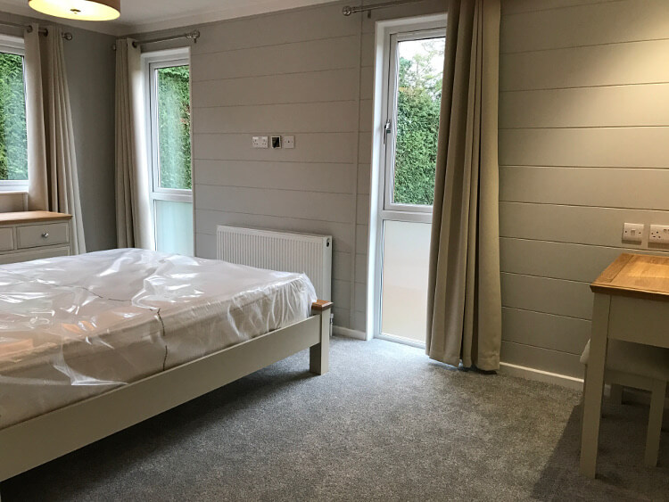 Interior shot of a bedroom in a lodge at Canterbury Reach