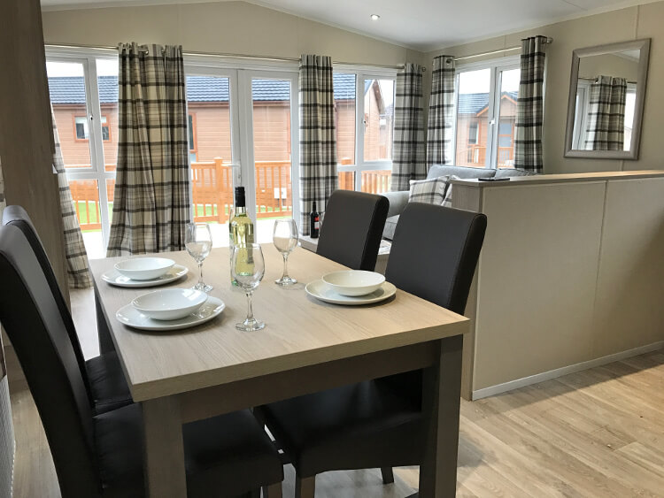 Interior shot of a Canterbury Reach lodge dining area and kitchen