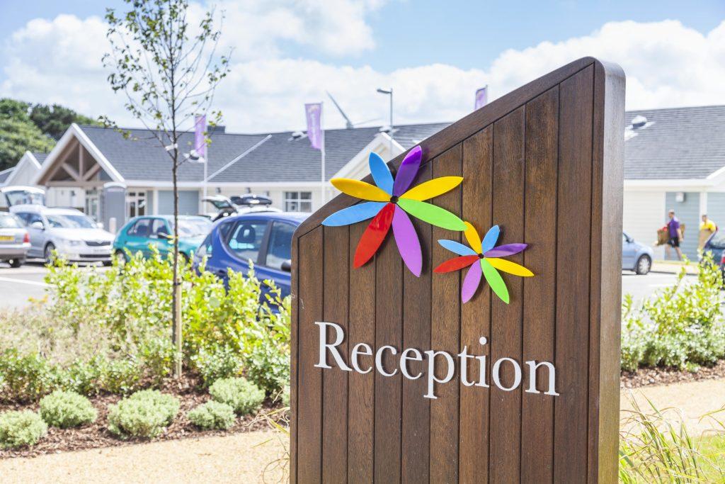 Reception sign post at Piran Meadows