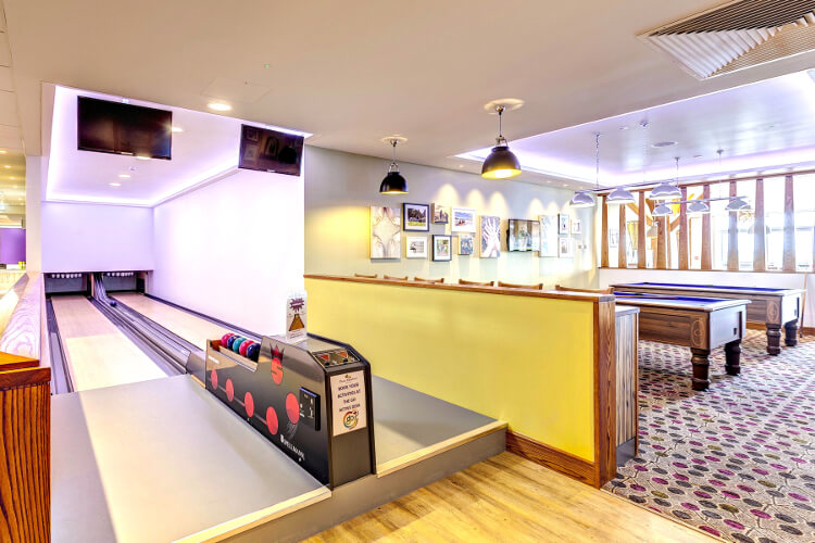 Interior shot of the bowling alleys and pool tables at Piran Meadows