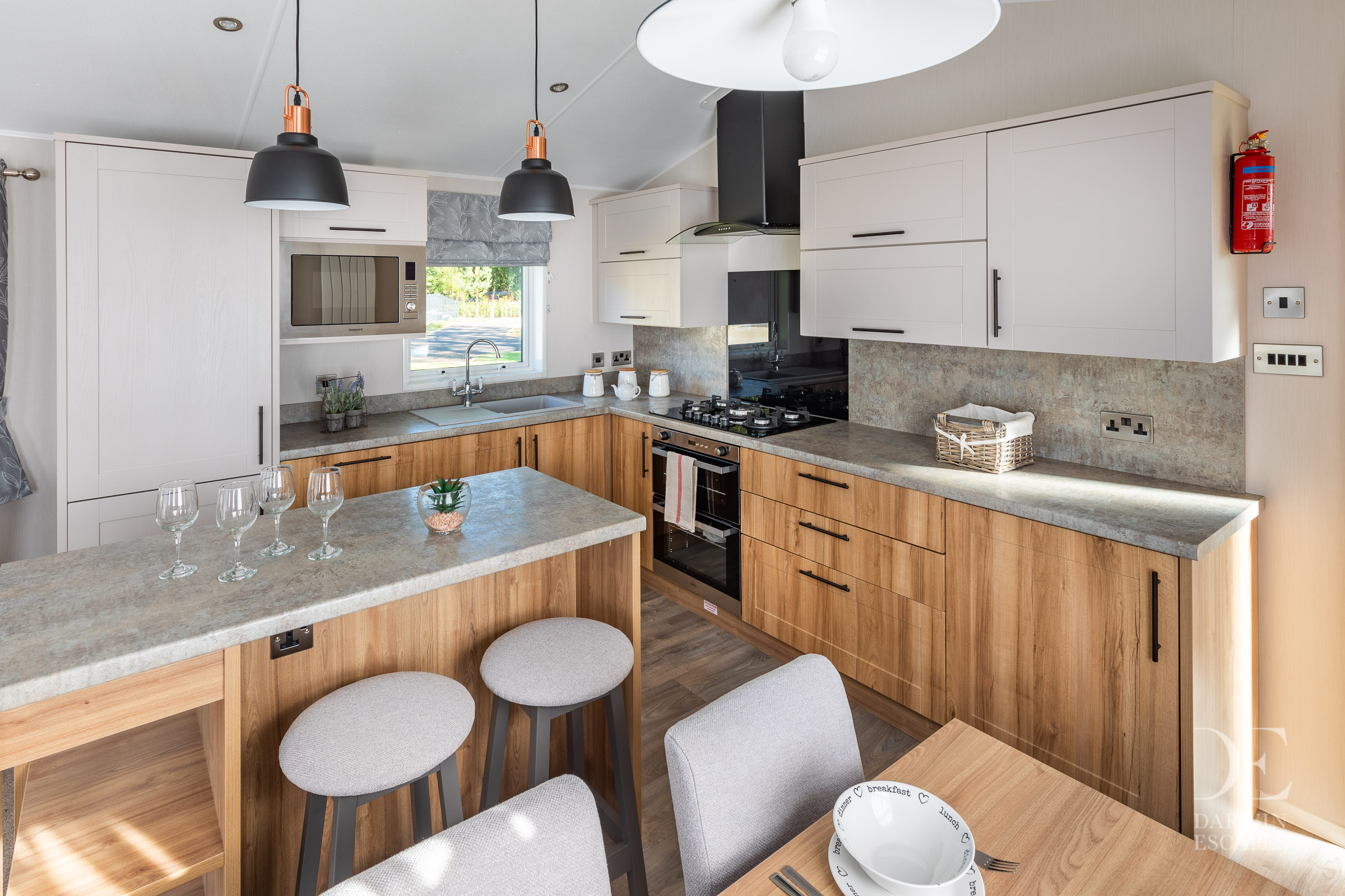 View of the kitchen in the Willerby Waverley with breakfast bar and dining table