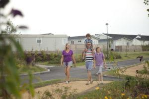 Young family walking through the resort at Piran Meadows