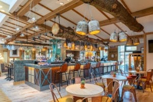 interior of bar with rustic styling and tables in restaurant area