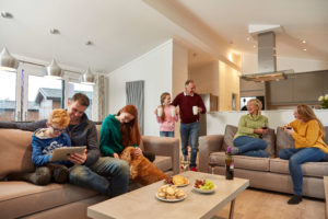 Family and their dog staying in accommodation at Norfolk Woods
