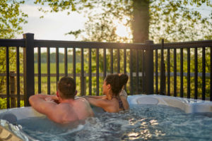 couple sat in a hot tub at Norfolk Woods