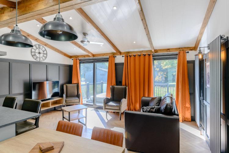 Elkstone interior with dark walls and orange curtains