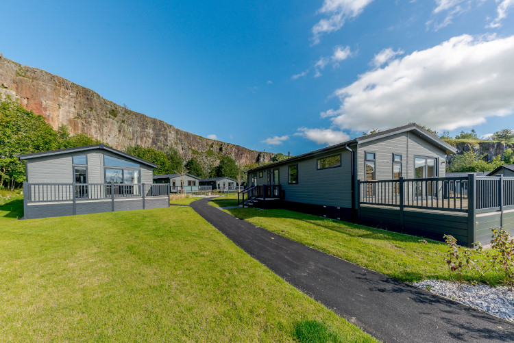 holiday lodges with quarry backdrop in rivendale