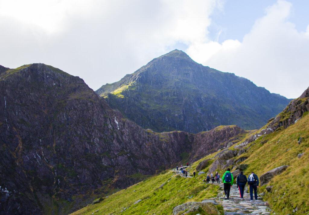 groups of people walking towards snowdonia