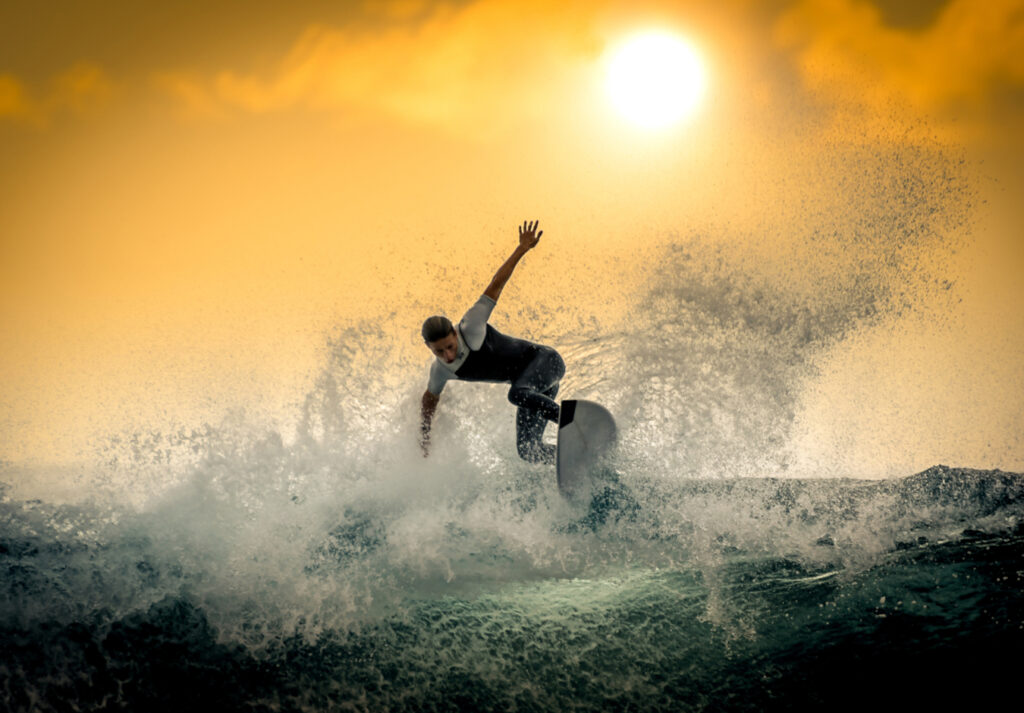 surfer on a wave at sunset