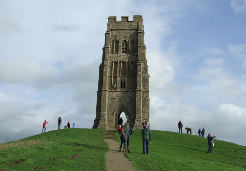 glastonbury tor up close with people standing on the hill